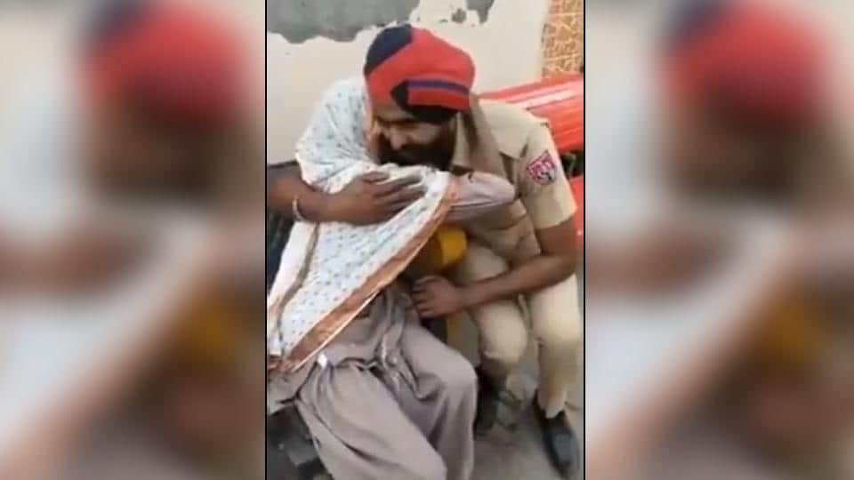 The video of policeman consoling a crying woman has gathered thousands of views.