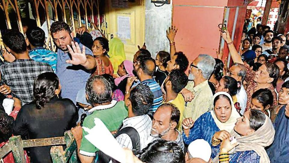 People queue up for a Digital Ration Card form in Kolkata. The West Bengal government began digitising ration cards in September.