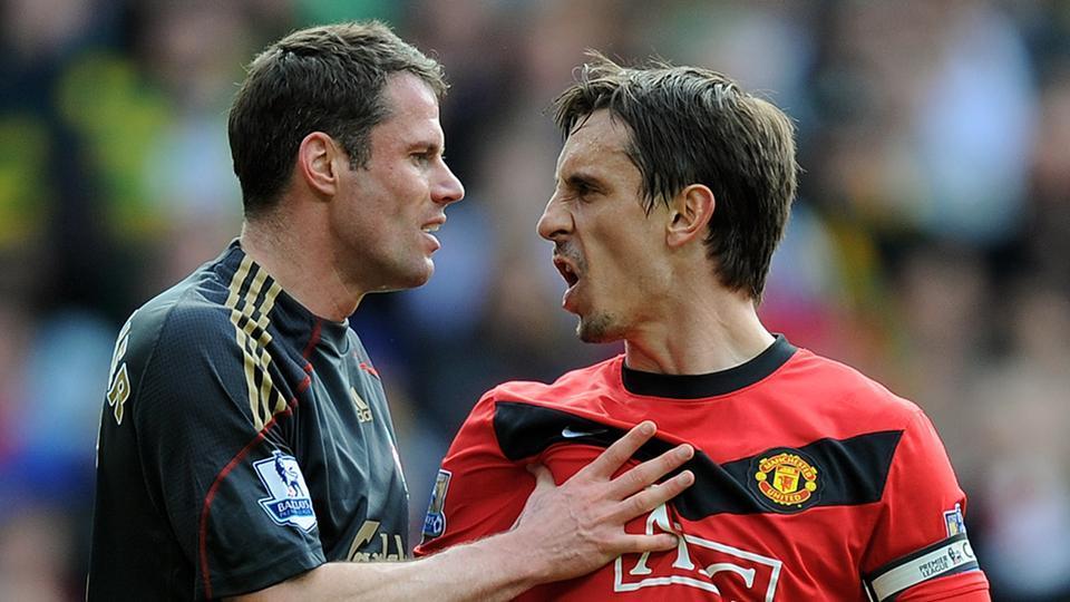 File image of former Liverpool defender Jamie Carragher and Manchester United defender Gary Neville (R).