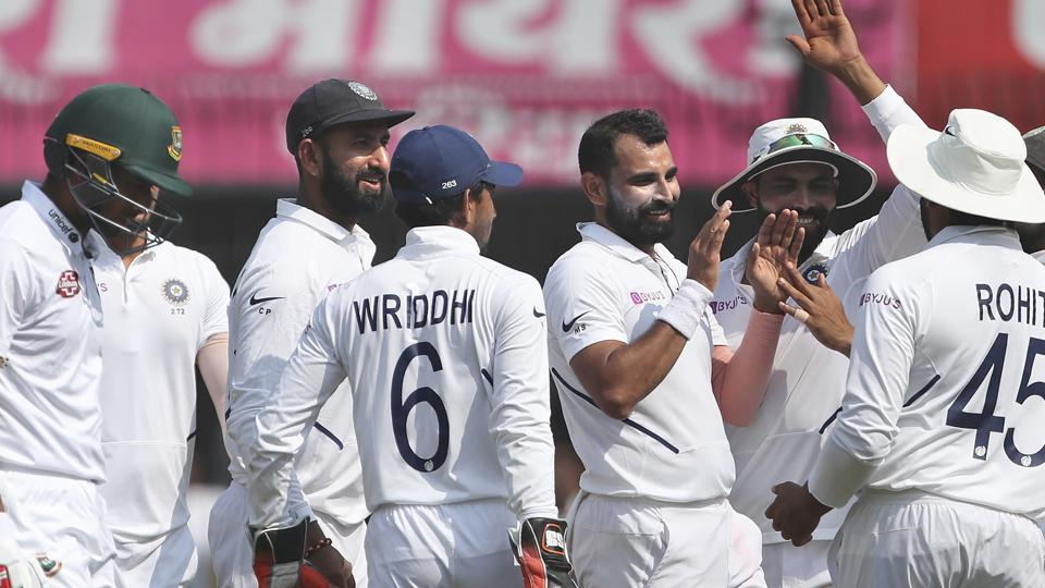 India's Mohammed Shami, third right, celebrates with teammates the dismissal of Bangladesh's Mahmudullah.
