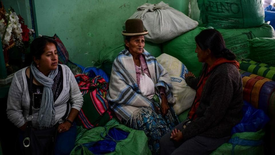 Women sit on sacks of coca leaves at the coca market. With 57,000 acres Bolivia is the world's third largest producer of the drug after Peru and Colombia. As a congressman in 1997, Morales had embraced the cause of the Chapare farmers to defend the chewing of coca leaves and other ancestral uses, despite pressure of the United States to eradicate the plantations that are also the raw material for cocaine. (Ronaldo Schemidt / AFP)