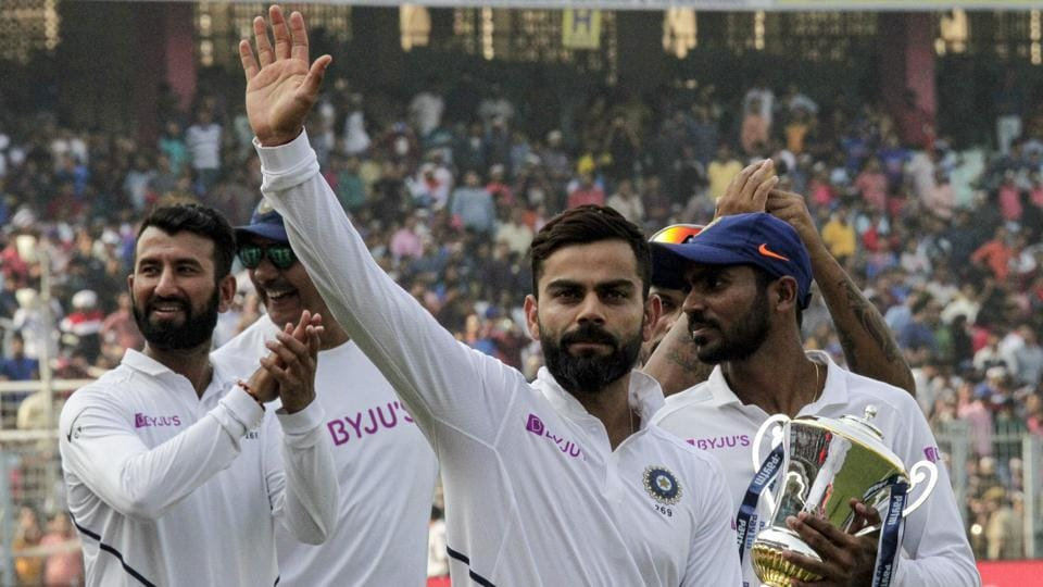 India's captain Virat Kohli gestures to spectators as he leads his team in a victory lap after winning the second match and test series against Bangladesh in Kolkata.