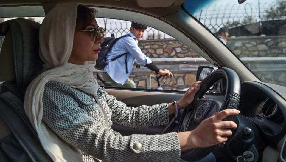 Fatima Mohammadi drives her car on the streets of Kabul. A first-of-its kind service called Pink Shuttle is helping women navigate the many challenges they face getting around Kabul, where a woeful lack of transport options is compounded by the risk of harassment on the streets. The service employs only women to ferry female passengers and their kids across the Afghan capital. (Wakil Kohsar / AFP)