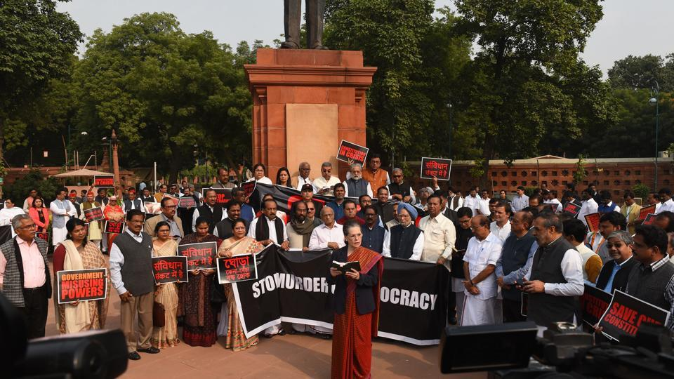 New Delhi, India - Nov. 26, 2019: Congress interim President Sonia Gandhi reads the constitution during a protest under the statue of Baba Saheb Bhimrao Ambedkar by members of opposition in Parliament after they boycotted the joint address called to commemorate the Constitution Day, due to recent political developments and Government formation in Maharashtra, in New Delhi, India, on Tuesday, November 26, 2019. (Photo by Mohd Zakir/ Hindustan Times)