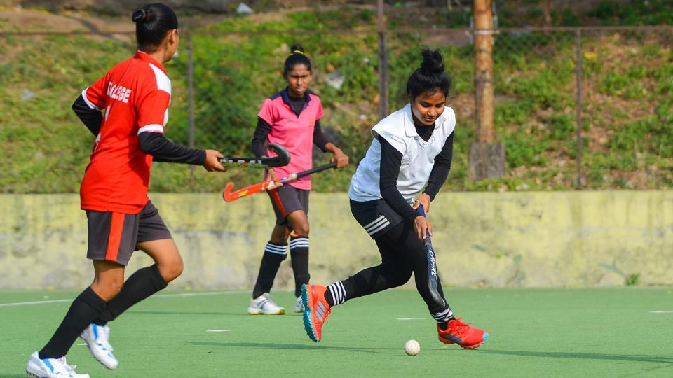 Players from Pune district women's hockey team during their practice session at Balewadi stadium in Pune on Tuesday.