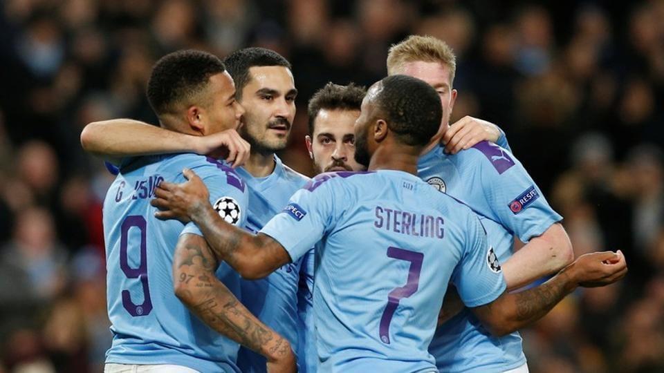 Manchester City's Ilkay Gundogan celebrates scoring their first goal with teammates.
