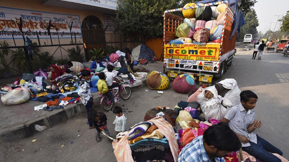 Used clothes being loaded on to a truck to be sent to Gujarat. Vendors will sell them to millions of people in villages and small towns of the state.