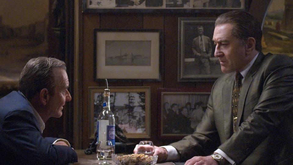 The Irishman movie review: Russell Bufalino (Joe Pesci) and Frank Sheeran (Robert De Niro) talk business.