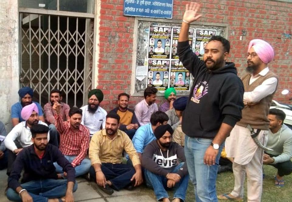 Students protesting outside the office of dean students welfare at Punjabi University in Patiala on Wednesday.