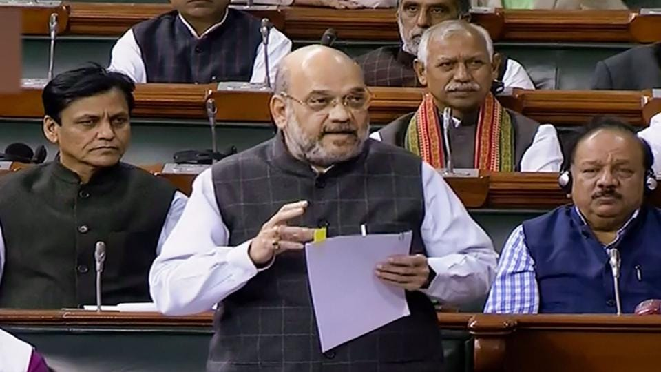 **EDS: TV GRAB** New Delhi: Union Home Minister Amit Shah speaks in the Lok Sabha during the Winter Session of Parliament, in New Delhi, Wednesday, Nov. 27, 2019. (LSTV/PTI Photo)(PTI11_27_2019_000128B)