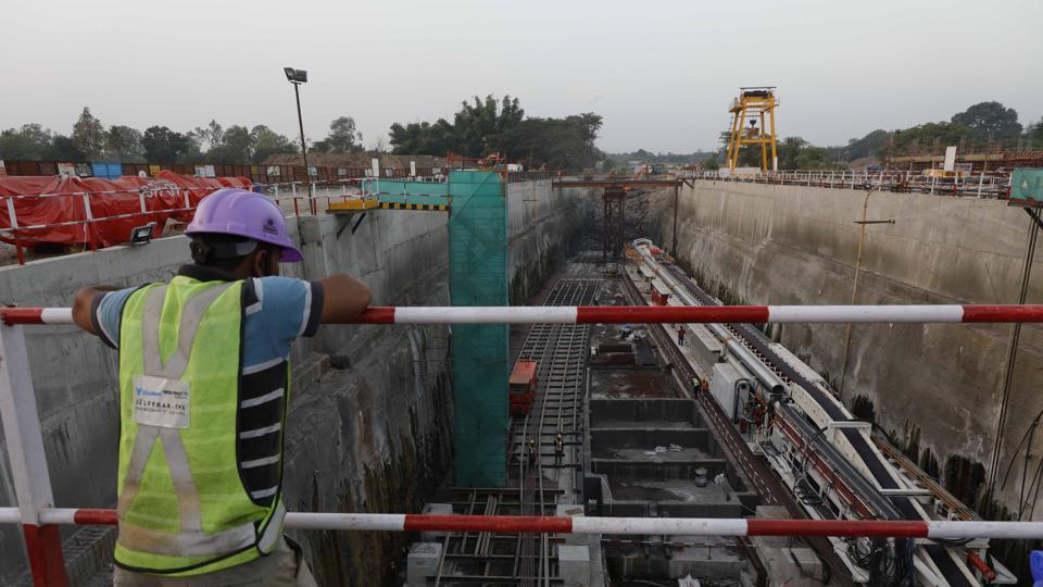 Workers at the agriculture college ground where the Tunnel Boring Machine of Pune metro will start work.