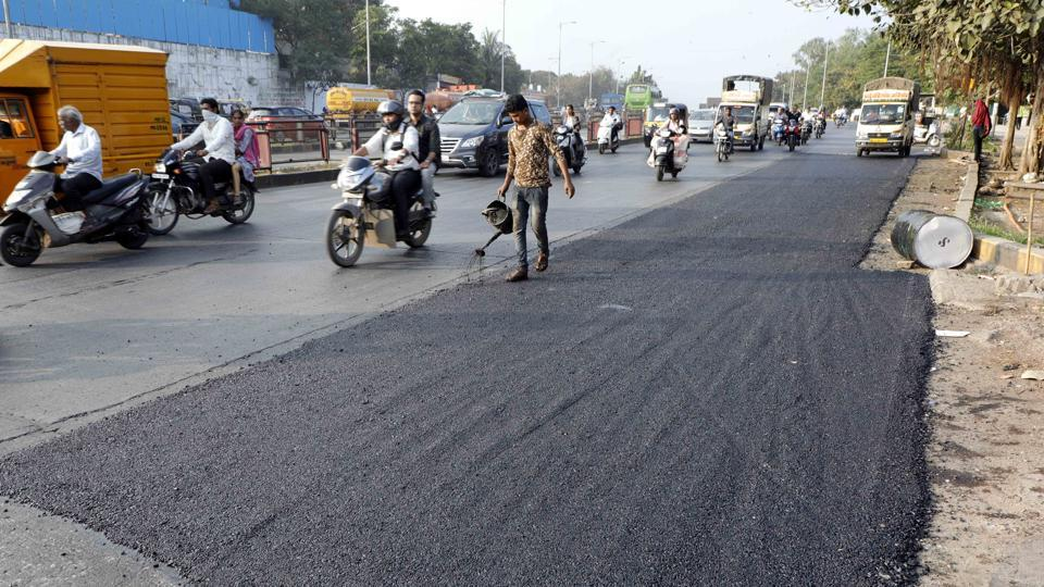 Road repair work underway by the PMC road department officials at Katraj, where the medical student lost her life, in Pune.