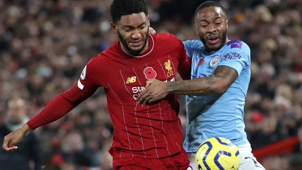 Liverpool's Joe Gomez in action with Manchester City's Raheem Sterling.