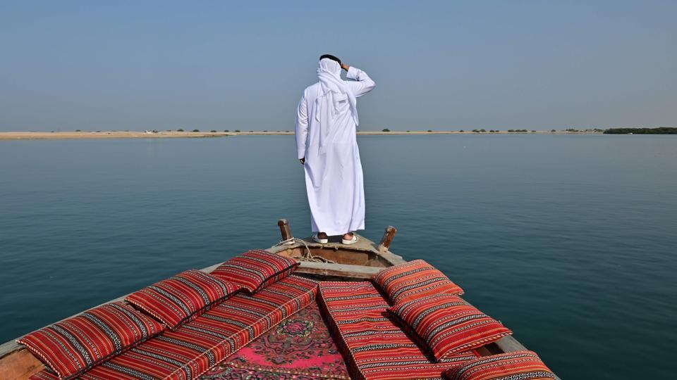 Emirati Abdullah al-Suwaidi watches the sea from his traditional dhow boat, at the Suwaidi pearl farm, off the coast of al-Rams in the northern emirate of Ras al-Khaimah, United Arab Emirates. Before the discovery of oil transformed the Gulf into one of the world's wealthiest regions, the fortunes of its people depended on pearling -- a tradition that Abdullah al-Suwaidi hopes to revive. (Guiseppe Cacace / AFP)