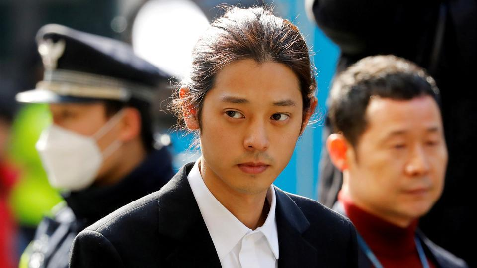 (File Photo): South Korean singer Jung Joon-young arrives for questioning on accusations of illicitly taping and sharing sex videos on social media, at the Seoul Metropolitan Police Agency in Seoul, South Korea, March 14, 2019.