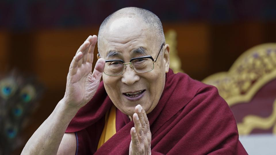 Tibetan spiritual leader the Dalai Lama greets devotees at the Buddha Park in Bomdila, Arunachal Pradesh.