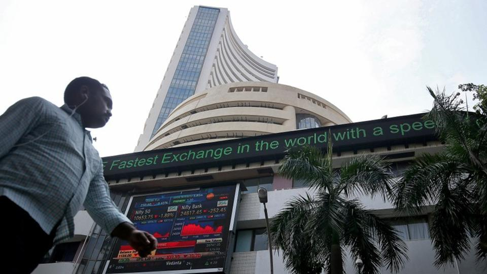A man walks past the Bombay Stock Exchange (BSE) building in Mumbai. On a monthly basis, Sensex gained 1.66% and Nifty was up 1.5% in November.