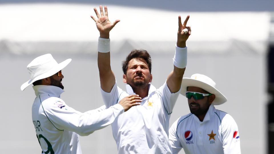 Pakistan's Yasir Shah, center, celebrates after he got the wicket of Australia's Steve Smith.