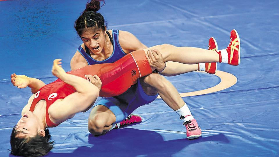 India's Vinesh Phogat (blue) in action against Japan's Yuki Irie during the final bout of women's freestyle 50 kg wrestling event, at the Asian Games 2018.