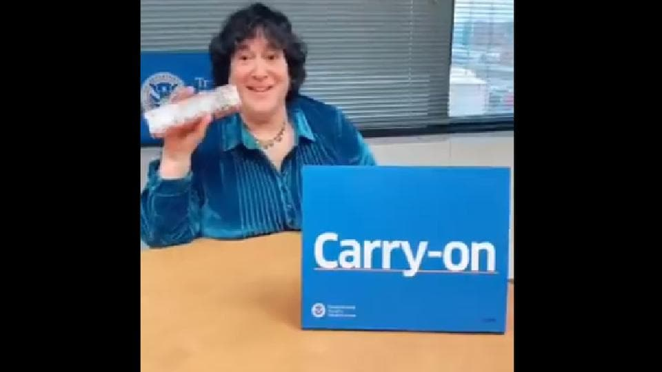 In the video, she gives a short demo of items which passengers are allowed to carry.