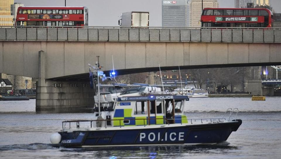 A police boat on the River Thames near London bridge following after an incident in central London Friday, Nov. 29, 2019.