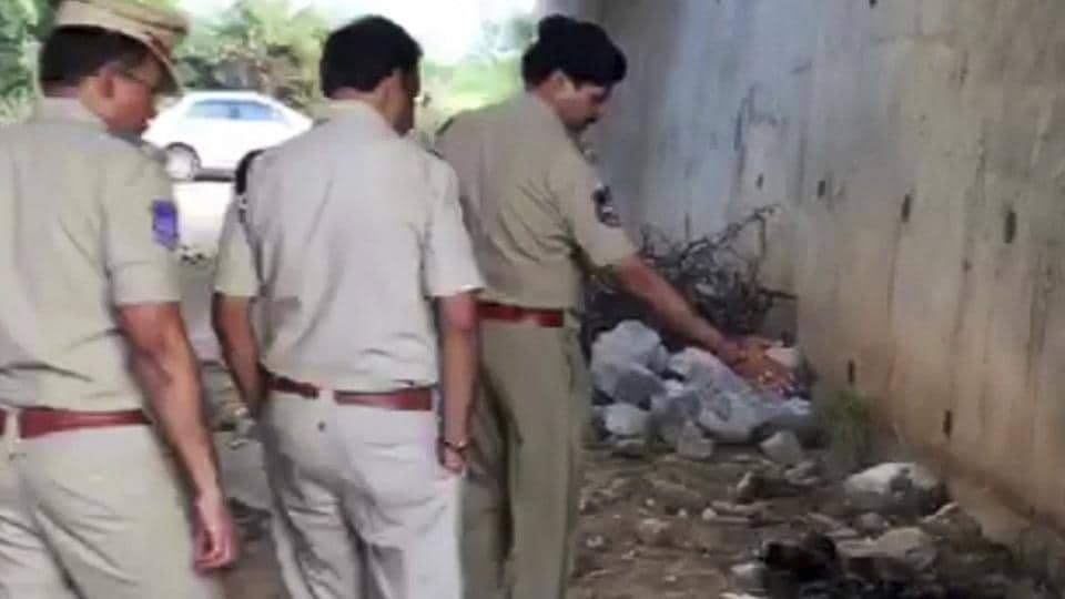 In this frame grab taken from video provided by KK Productions, Indian police officers inspect the site where they found the burned body of a 27-year-old veterinary doctor who they say was raped and killed on the outskirts of Hyderabad.
