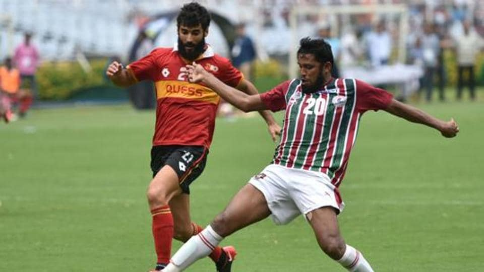 Suhair VP (20) of Mohun Bagan and Marti Crepsi (21) of East Bengal in action during their Calcutta Football League 2019 match at Salt Lake stadium.