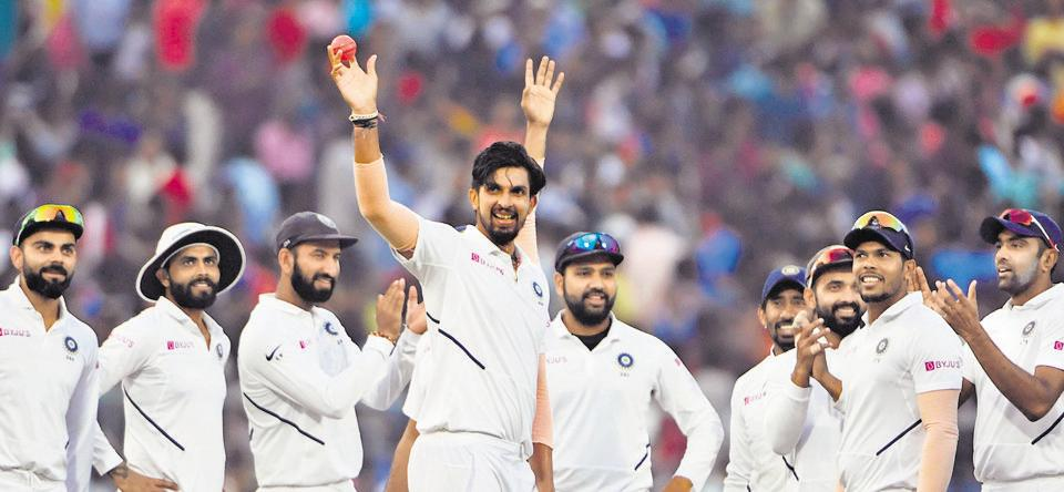 Ishant Sharma (C) shows the pink ball as he celebrates his five-wicket haul with teammates during the first of the second Test match, which is the first-ever pink ball day-night Test match between India and Bangladesh at Eden Gardens in Kolkata on November 22.