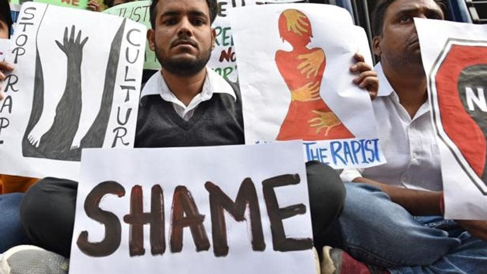Students from different organisations hold placards to protest against the Telangana government over the rape and murder of a veterinary doctor in Hyderabad, at Parliament Street, in New Delhi, India, on Saturday, November 30, 2019.