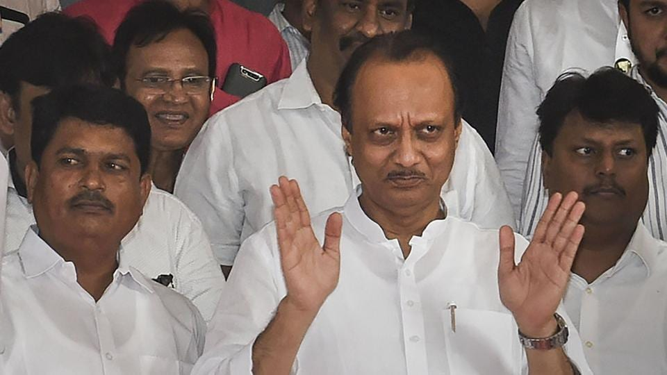 NCP leader Ajit Pawar gestures as he leaves after the Shiv Sena-NCP-Congress alliance won the floor test in the Maharashtra Assembly, outside the Vidhan Bhawan in Mumbai, Saturday, Nov. 30, 2019.