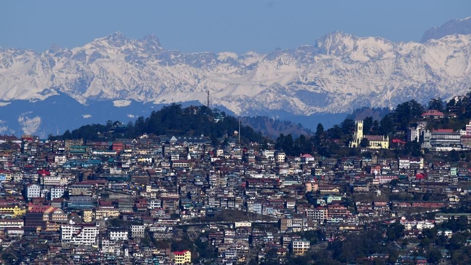 A scenic view of Shimla from Tara Devi with the snow-clad Himalayan range in the backdrop, in Himachal Pradesh. (Deepak Sansta / HT Photo)