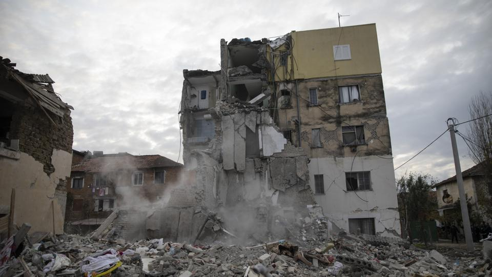 Dust rises from the falling parts of a destroyed building during an aftershock in Thumane, western Albania. The 6.4-magnitude quake that hit Albania's Adriatic coast before dawn on Tuesday last week has left at least 51 people dead, around 2,000 others injured and about 4,000 people homeless. (Petros Giannakouris / AP)