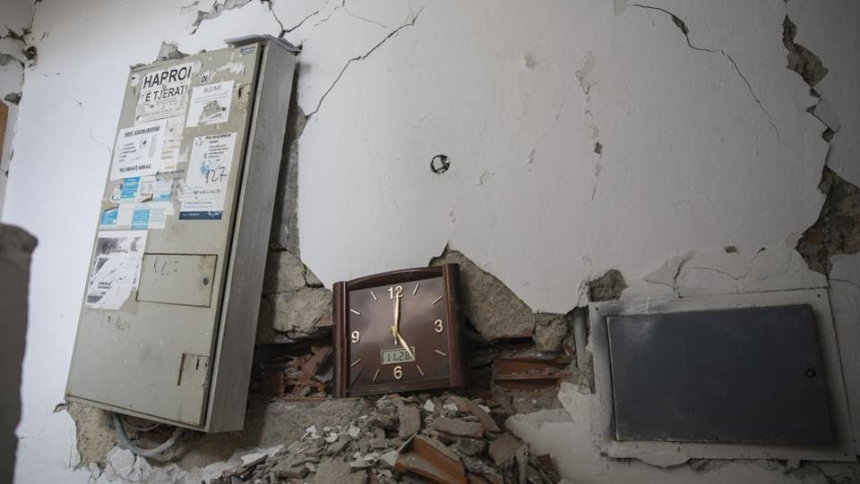 A wall clock that stopped working during the time of the earthquake is seen inside a damaged building in Durres. The first seriously damaged building has been demolished, and a dozen others are expected to follow. Assessment experts from Greece, France, Italy, Hungary, Bulgaria, Lithuania and Latvia are involved. (Petros Giannakouris / AP)
