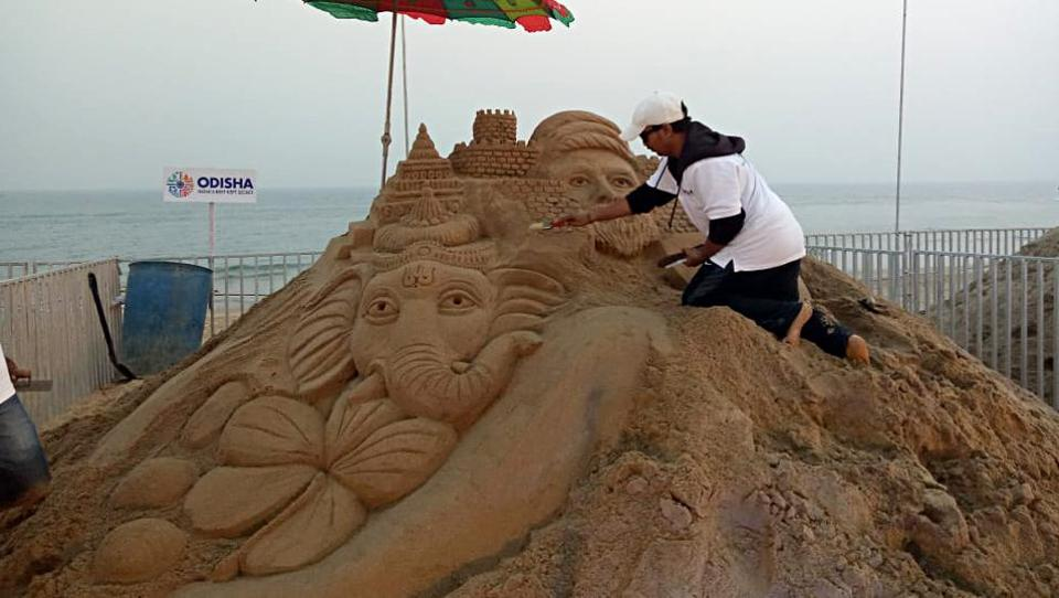 A sand artist gives finishing touch during the celebration on the occasion of International Sand Art Festival, at Chandrabhaga beach in Konark on Sunday. 123 artists from across India & artists from USA, Ireland, Denmark, Russia, Canada, Togo & Sri Lanka are participating in Sand Art Festival.