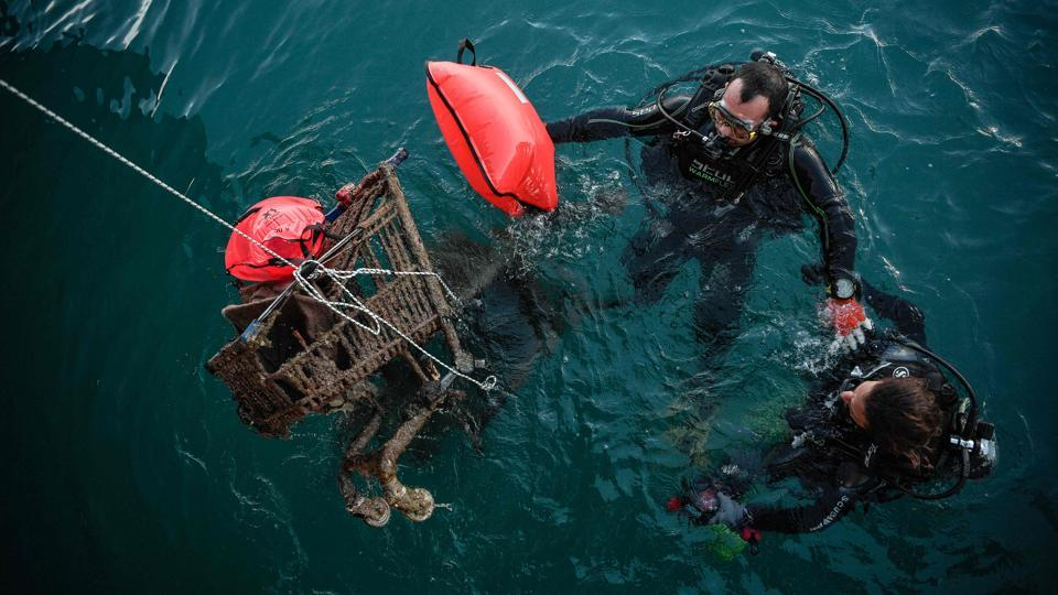 "Volunteer divers retrieve rusted shopping carts from the sea in the port of the Ionian island of Zakynthos. Dressed in her protective wetsuit and scuba gear, Antigone Kouteri jumped into the murky waters of Zakynthos harbour in search of plastics -- and promptly snagged her arm on a submerged object. ""It was a tyre,"" offered her patrol mate Efthymis, coming up with a discarded beer bottle. ""My treat!"" he jibed. (Louisa Gouliamaki / AFP)"