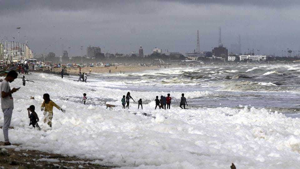 Doctors have warned that skin problems could be caused by the foam, which forms every monsoon season but has been particularly bad this year. Word has not got through to the hundreds of families who throng India's longest urban beach, letting children happily skip in the toxin-filled froth. (R Parthibhan / AP)