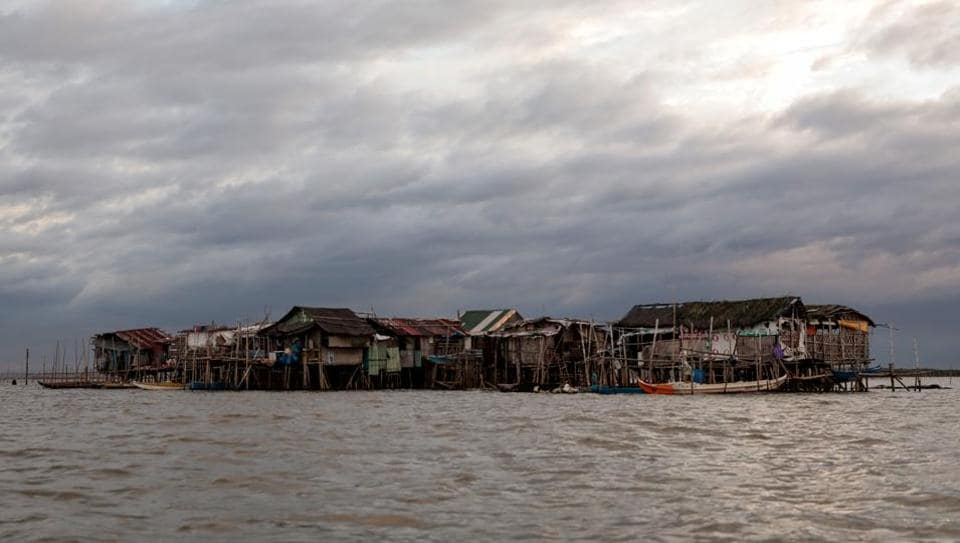 Bamboo huts are risen on stilts in the submerged coastal island Sitio Pariahan, Bulakan, Bulacan, north of Manila, Philippines. Sitio Pariahan, about 17 km north of Manila, is sinking about 4 cm (1.5 inches) every year, owing largely to land subsidence from the population's overuse of groundwater, according to experts. (REUTERS)