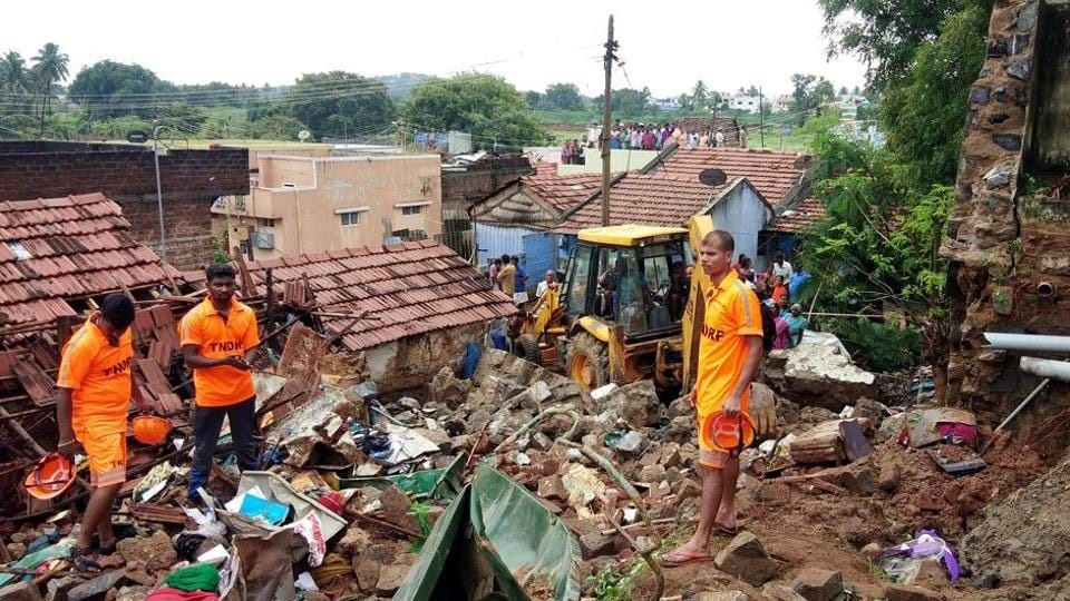 Rescue workers clear debris from a collapsed home in Mettupalayam, some 50 kilometers north of Coimbatore, on Monday. At least 17 people from four families were buried alive as they were sleeping when heavy rains caused a large wall to collapse on their homes, police said.