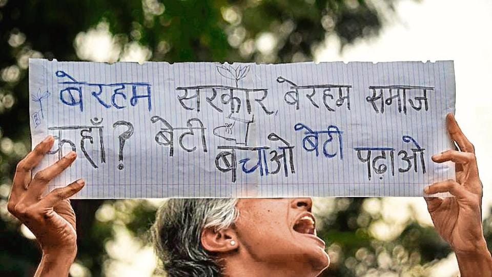 People shout slogans and hold placards during a protest in Mumbai  against the gang rape and murder of a veterinarian on the outskirts of Hyderabad,  Monday, December 2, 2019.