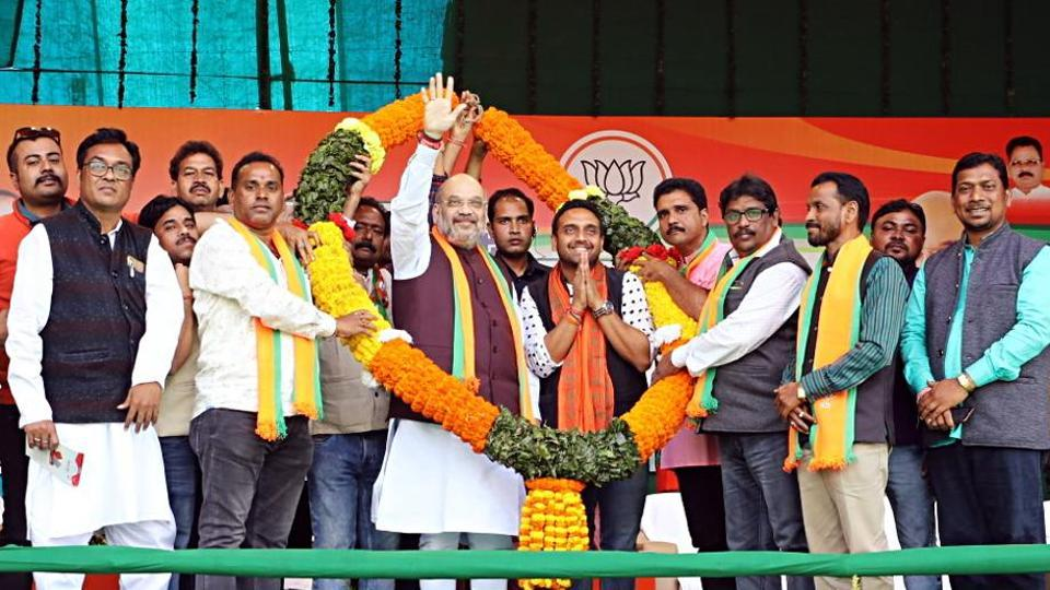 Union Home Minister and BJP National President Amit Shah being felicitated by party workers during an election rally in Baharagora, Jharkhand.