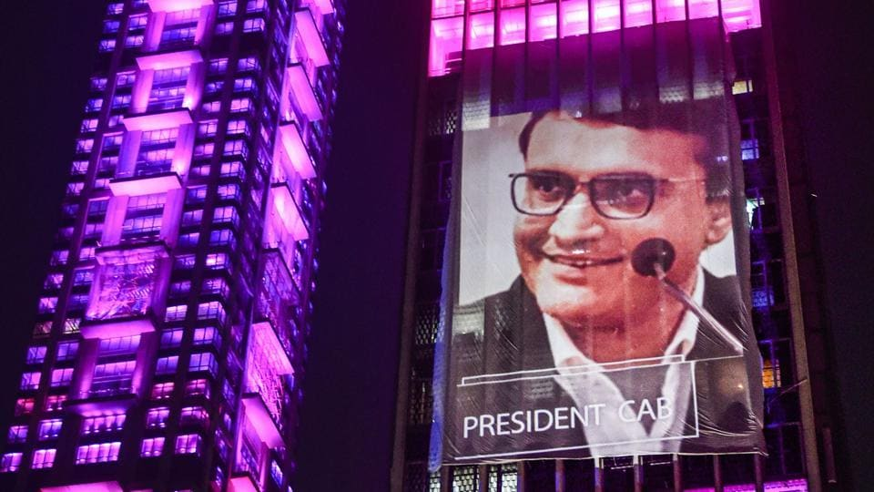An illuminated building displays an image of BCCI President Sourav Ganguly.