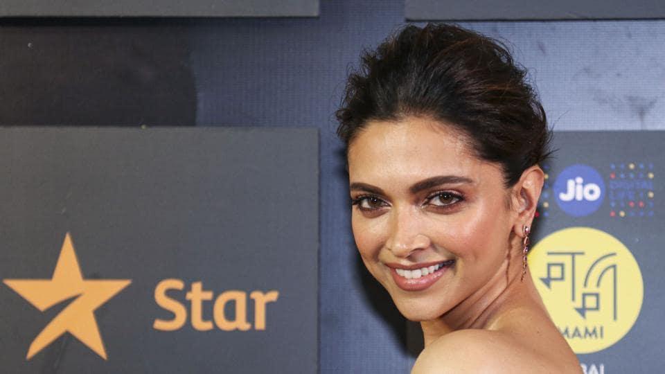 Deepika Padukone poses for photographs as she attends 'Jio MAMI 21st Mumbai Film Festival' in Mumbai.