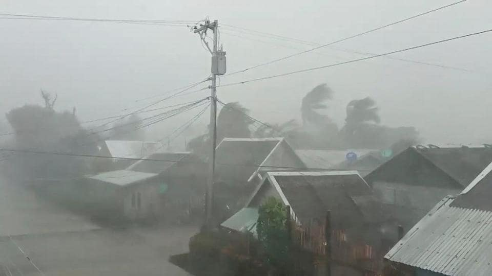 Trees sway near buildings as Typhoon Kammuri, known locally as Typhoon Tisoy, makes landfall in Gamay on December 2. Five people died in the central Bicol region, including three who drowned, a local disaster agency said in a report according to news agency Reuters. Five more were killed in a region south of the capital. (Gladys Castillo Vidal via REUTERS)