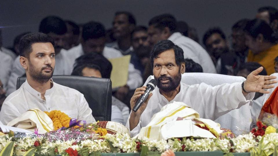 Union Food and Consumer Affairs Minister Ram Vilas Paswan addresses party workers as Lok Janshakti Party National President Chirag Paswan looks on during the party's foundation day celebration, in Patna.