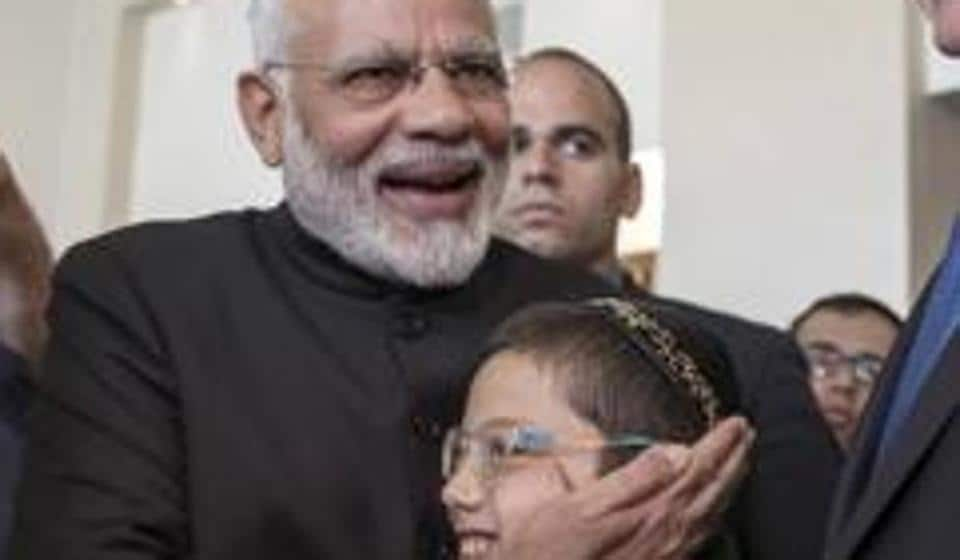 Prime Minister Narendra Modi with Moshe Holtzberg, center, an Israeli boy, whose parents were killed in the November 26, 2008 terrorist attack on the Mumbai Chabad House, in Jerusalem, July 5, 2017.