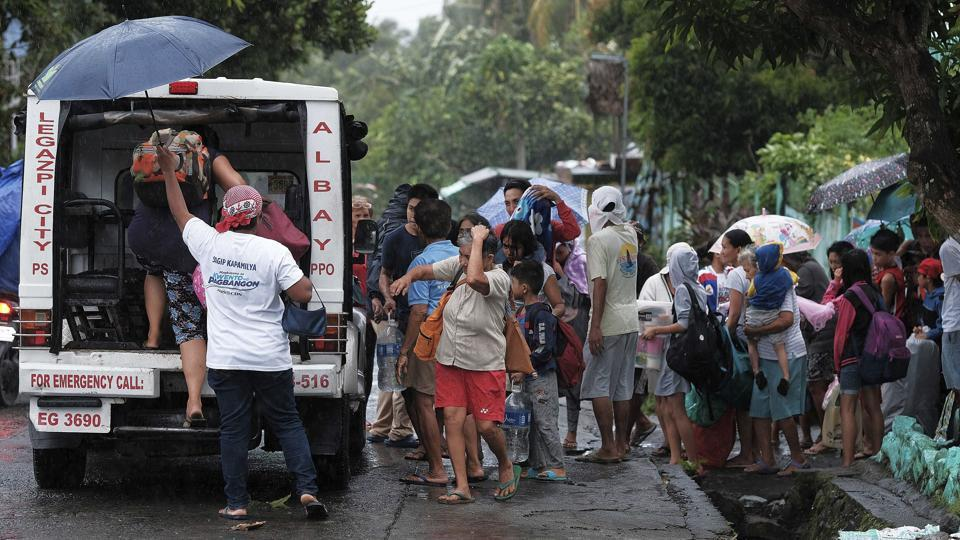 Residents evacuate their area ahead of Typhoon Kammuri in Legazpi, Albay province on December 2. Ahead of the storm's arrival a 33-year-old man was electrocuted on Monday while securing a roof against the winds, which by late Tuesday weakened to a maximum of 140 kilometres per hour from a high of 165 kmph. (AP)