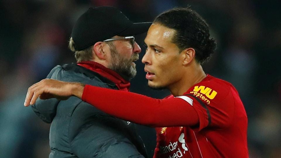 Liverpool manager Juergen Klopp and Virgil van Dijk celebrate after the match.
