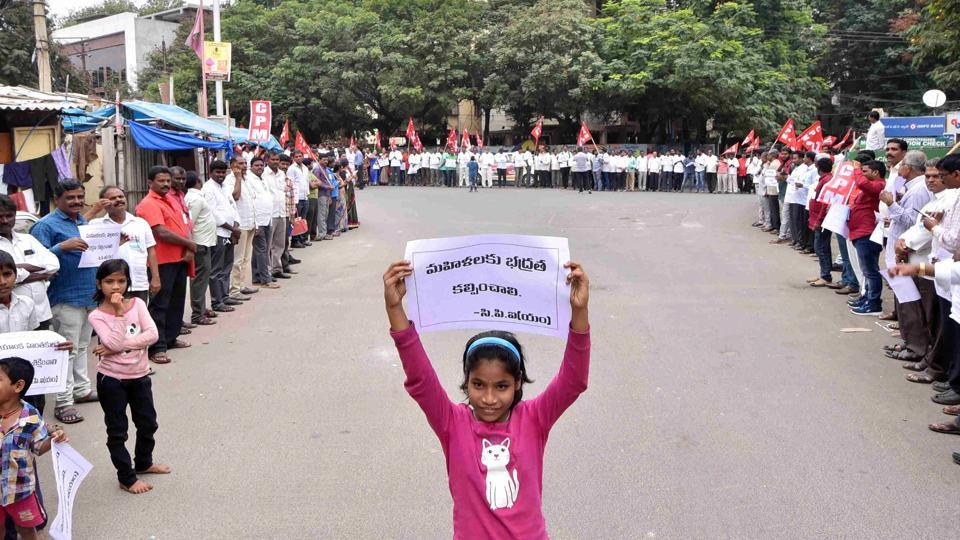 A young girl holds a placard as protestors form a human chain demandingjusticefor the rape and murder of a 25-year-old veterinarian, in Hyderabad.