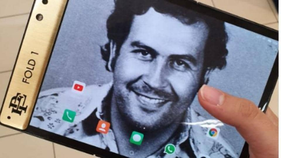 The Escobar Fold 1 smartphone with Pablo Escobar as the wallpaper.