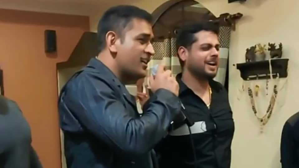 MS Dhoni singing at a party.